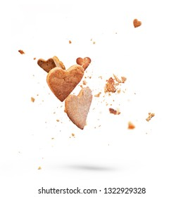 Card with flying crisp biscuit cookies. Shape of heart. Isolated white background. Concept of women, mothers, valentines day holidays. Levitation in air