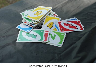Card game on table while camping