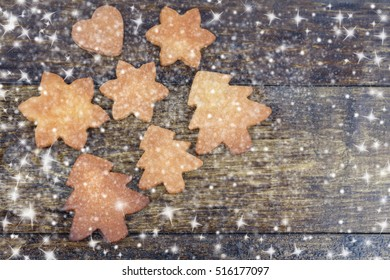 Card with Gingerbread Cookies and copy space.Figures of Stars,Heart,Fir Tree.Selective field of focus.