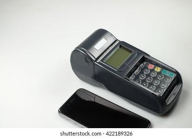 Card machine, black smartphone on white background.