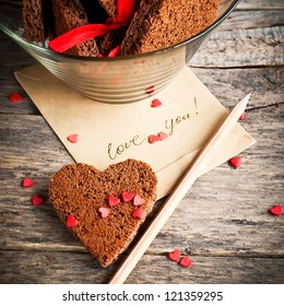 Card with Message Love You in the Letter and Chocolate Cookies in the Shape of Heart at Valentine Day