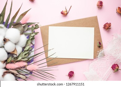 card mockup with bouquet of dried flowers cotton flowers, lagurus ovatus. pink spikes, palm leaves. eucaliptus