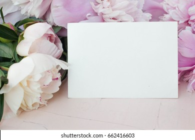 card mockup with flowers. peony, invitation and ribbon