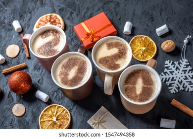 Card with numbers 2020 for New year and Christmas. Cup of coffee with figures on milk foam on black background. The view from the top. Flat lay