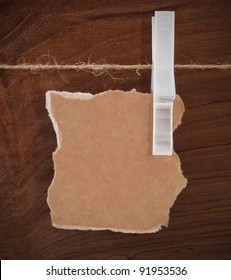 Card on the rope over wooden background