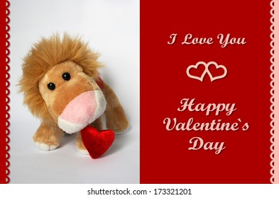 ValentineaÂ?Â?s Card with plush lion toy holding red heart