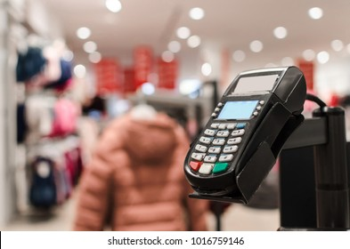 card reader in clothing store, spring sale, reading device, pin code, consumerist society and great sale concept