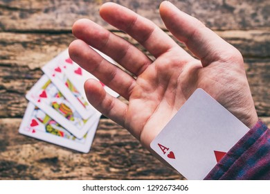 card sharper hides an ace up his sleeve in close-up