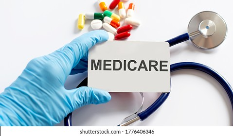 Card with text MEDICARE supplies, pills and stethoscope. Medical concept.