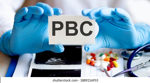 Card with text PBC supplies, pills and stethoscope. Medical concept.