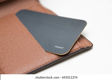 card in wallet on white background