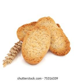 Cardamom crispbread rolls with wheat sprig, over white background. Swedish specialty, skorpor kardemumma.