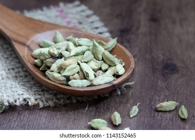 cardamom on a wooden spoon