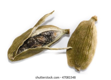 Cardamom pods - one opened the other a full pod