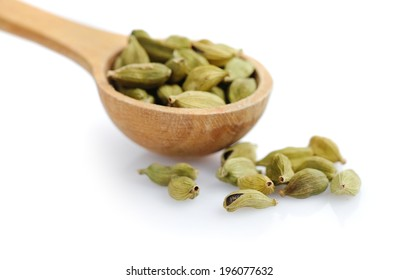 Cardamom seeds on white background