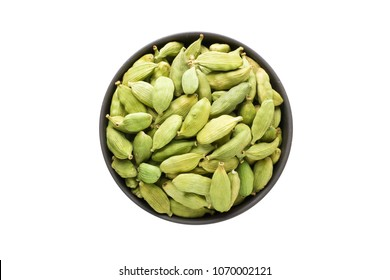 cardamom seeds, top view, isolated on a white background. organic spice