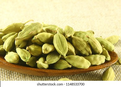 cardamom spice seed pods isolated closeup