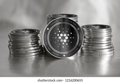 Cardano (ADA) digital crypto currency. Stack of black and silver coins. Cyber money.