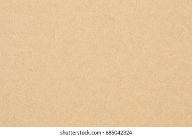 Cardboard background from old processing trash paper