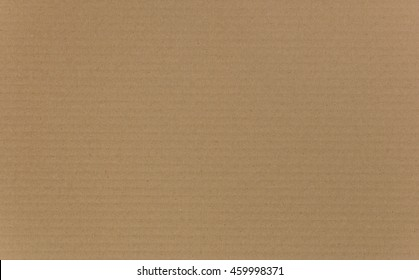 Cardboard background traditionally made from recycled paper with ridged texture detail.