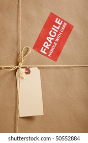A cardboard box background with Blank shipping label and twine