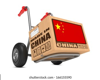 Cardboard Box with Flag of China and Made in China Slogan on Hand Truck White Background. Free Shipping Concept.
