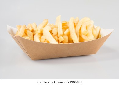 cardboard box of French fries in a takeaway dish of a snack
