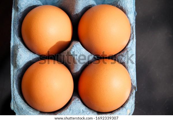 Cardboard box of fresh eggs