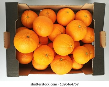 cardboard box with fresh oranges, top view