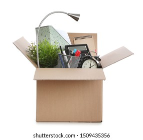 Cardboard box full of office stuff on white background
