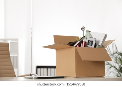 Cardboard box full of stuff on table in office