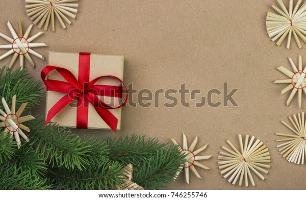 Cardboard box, handmade gift, christmas tree branch and woody vintage decorations in Scandinavian style