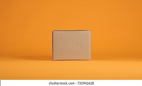 Cardboard box on orange background