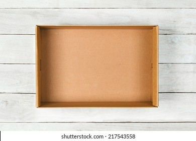 Cardboard box on a white wooden background