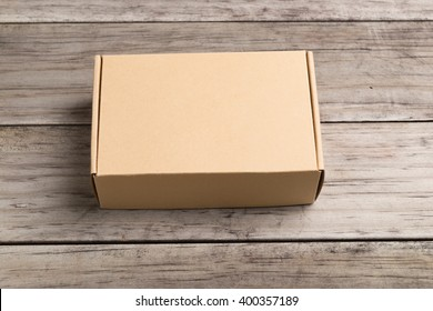 Cardboard box on a  wooden background