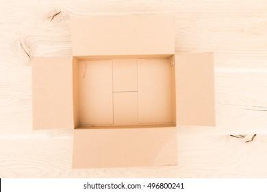 cardboard box on a wooden board