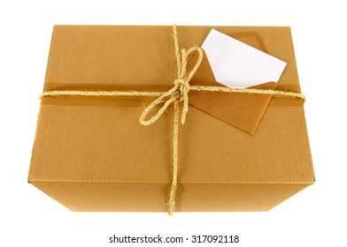 Cardboard box with rope and blank message card, top view