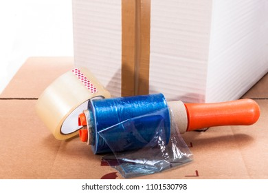Cardboard box, scotch tape and nylon on a white background