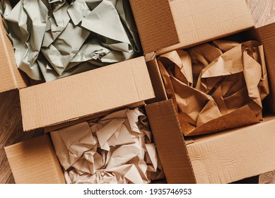 Cardboard boxes with crumpled paper inside for packaging goods from online stores, eco friendly packaging made of recyclable raw materials - Shutterstock ID 1935746953