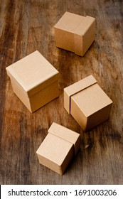 Cardboard boxes of different sizes with lids. Background for gift wrapping. Products from natural materials.