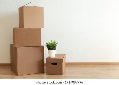 Cardboard boxes in empty room, movement concept. No people
