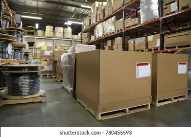 Cardboard boxes inside warehouse with telecom equipment stored inside