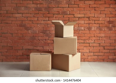 Cardboard boxes near brick wall