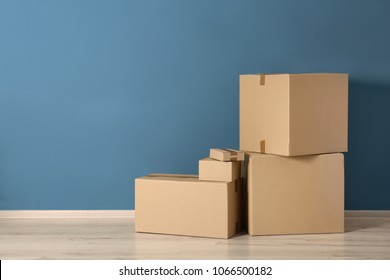 Cardboard boxes near color wall