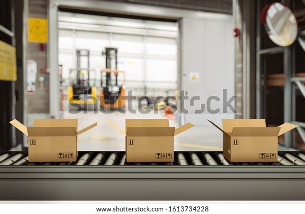 Cardboard boxes on conveyor rollers inside a warehouse ready to be shipped by courier for distribution