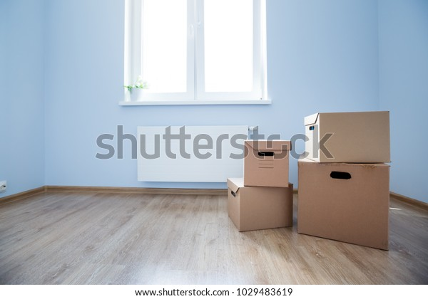 Cardboard Boxes On Laminate Floor Empty Stock Photo Edit Now