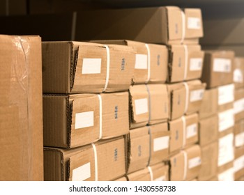 cardboard boxes on the shelf are stacked. Packaging of building materials in boxes for loading. Preparing to move to a housewarming party