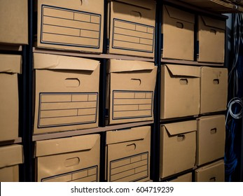 Cardboard boxes on the shelves in the Files storage room