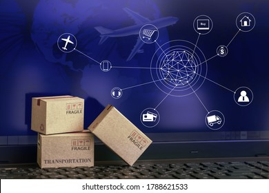 Cardboard boxes packaging the products on computer notebook background. concept about transportation or global shipping or international freight,overseas trade. online shopping concept.