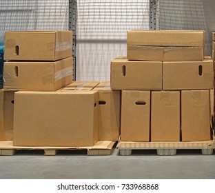 Cardboard boxes at pallets in storage